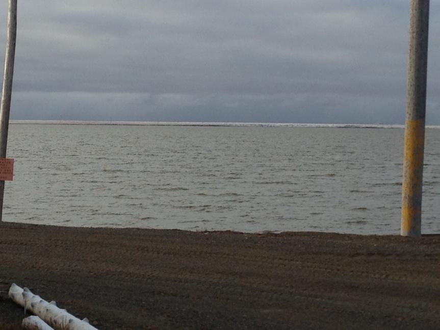 Snow on the tundra, seen across Middle Salt Lagoon.