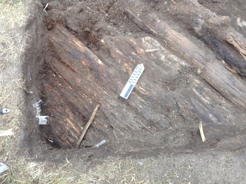 Probable tent floor after cleaning.  Pot was located in the lower left corner, left of the stick.  The oil patch surrounds the North arrow.