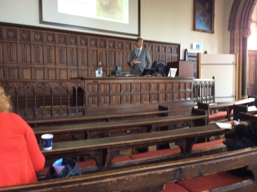 Nuvuk Archaeology Project alum Dr. Tony Krus chairing a session in a centuries-old lecture hall