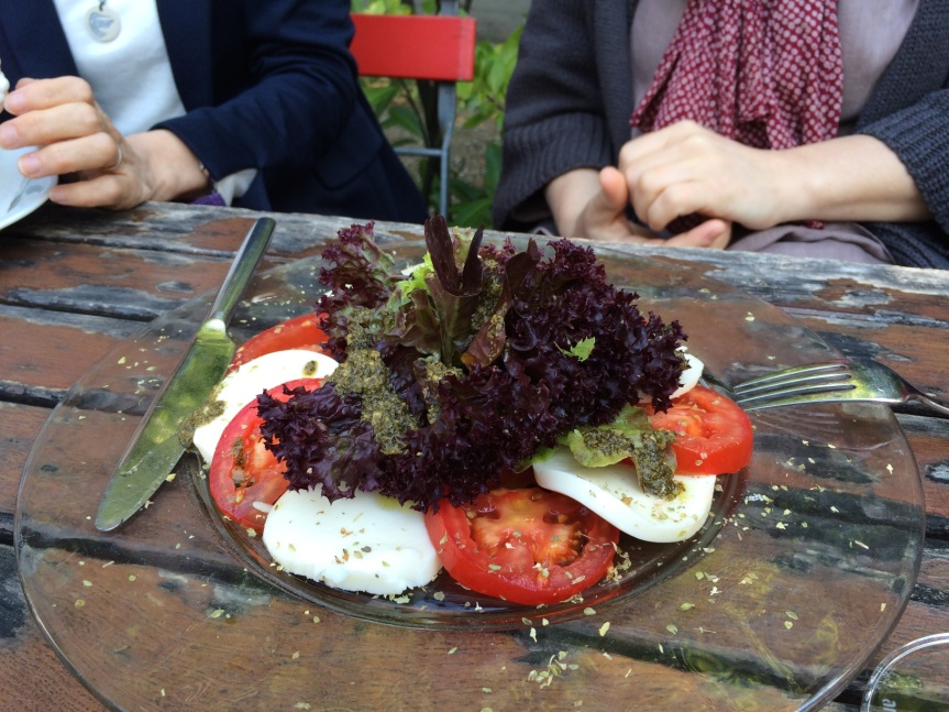 Seriously large (and very carefully arranged) caprese salad).