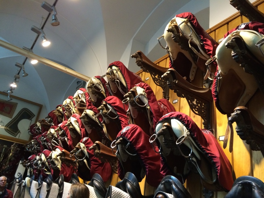 Saddles in the tack room at the Winter Riding School.