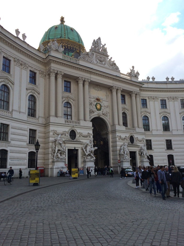 Entrance to the Hofburg from Michaelerplatz. The Riding School is on the left of the main archway.